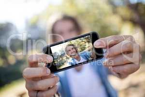 Man taking picture of himself on mobile phone