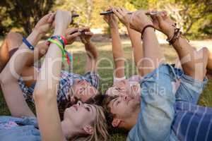 Friends clicking selfie on mobile phones