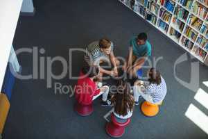 Students interacting with each other in library