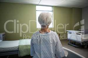 Thoughtful senior patient sitting at hospital