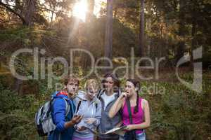 Group of friends looking at the map while hiking
