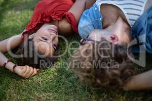Couple lying on grass in park