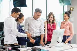 Business colleagues discussing during meeting at desk