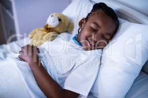 Patient sleeping with teddy bear