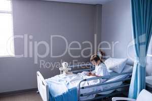 Patient using digital tablet in ward