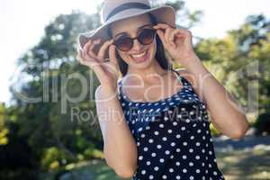Happy woman wearing sunglasses and hat