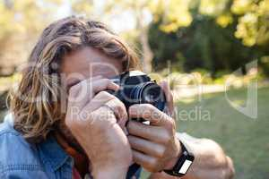 Man taking picture with digital camera