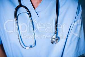 Male doctor with stethoscope in ward at hospital