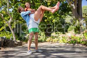 Man carrying woman in park