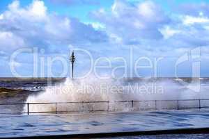 stormy sea breaching fence at crosby merseyside uk