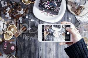 process of photographing the smartphone table with food and drin