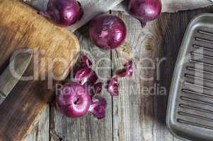 Red onion vegetable on the gray wooden surface