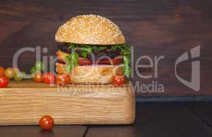 Meat sandwich sesame bun on a kitchen board