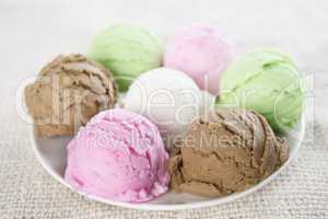 Assorted ice cream scoops on plate.
