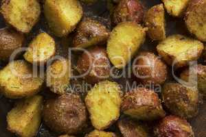 Oven baked potatoes close up