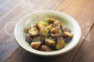 Oven roasted potatoes on wood table