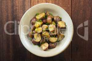 Oven roasted potatoes on wooden table top view