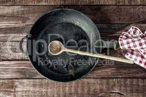 Black iron pan with a wooden handle