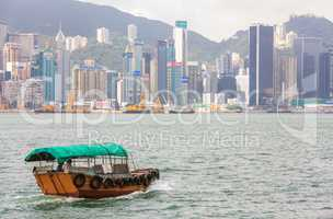 Traditional Boat in front of Hong Kong Harbour Skyline