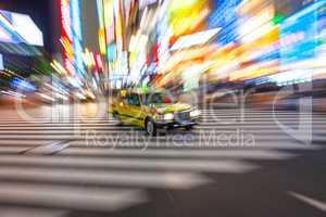 Motion Blurred Taxi on Crossing, Shibuya, Tokyo, Japan