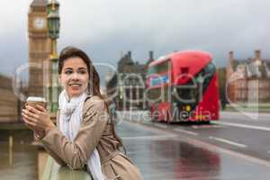Woman Drinking Coffee on Westminster Bridge, Big Ben, London, En