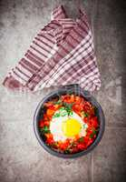 Traditional Middle Eastern dish of Shakshuka in a pan.