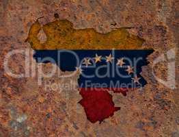 Karte und Fahne von Venezuela auf rostigem Metall