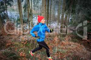running in the wintry forest