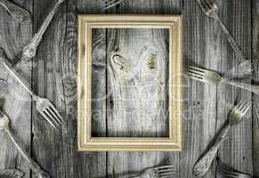 empty wooden frame on a gray wooden surface