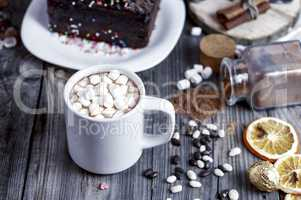 Cocoa with marshmallow on a gray wooden surface
