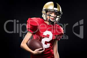 Female american football player in sportswear