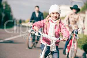 Cute little girl riding bicycle