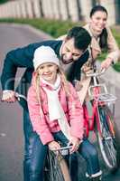 Happy family with bicycles