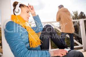 Beautiful woman in headphones listening music