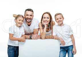 Cheerful family standing together
