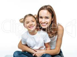 Smiling mother hugging daughter