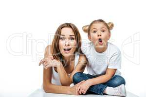 Shocked mother and daughter