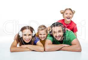 Parents in headphones with kids