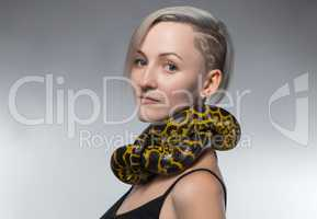 Woman with yellow snake on her neck