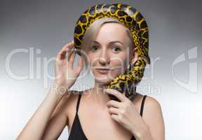 Blond woman and snake on her head