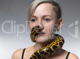 Blond woman and crawling snake