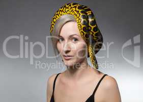 Woman and snake on her head
