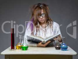 Reading serious scientist with glass flask