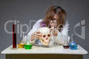 Exploring scientist with human skull
