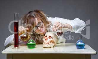 Mixing liquid scientist with human skull