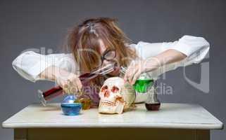 Mixing liquid professor with human skull