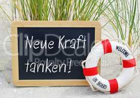 Neue Kraft tanken - Kreidetafel am Strand