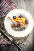 Roasted duck leg with mashed carrot and dried prunes