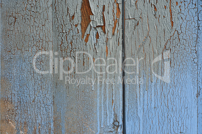 Wooden blue surface with cracks and scuffs