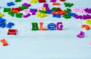 Word blog from small multicolored wooden letters on a white surf